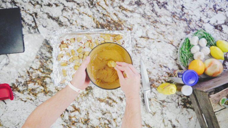 Dipping homemade chicken nuggets in honey mustard