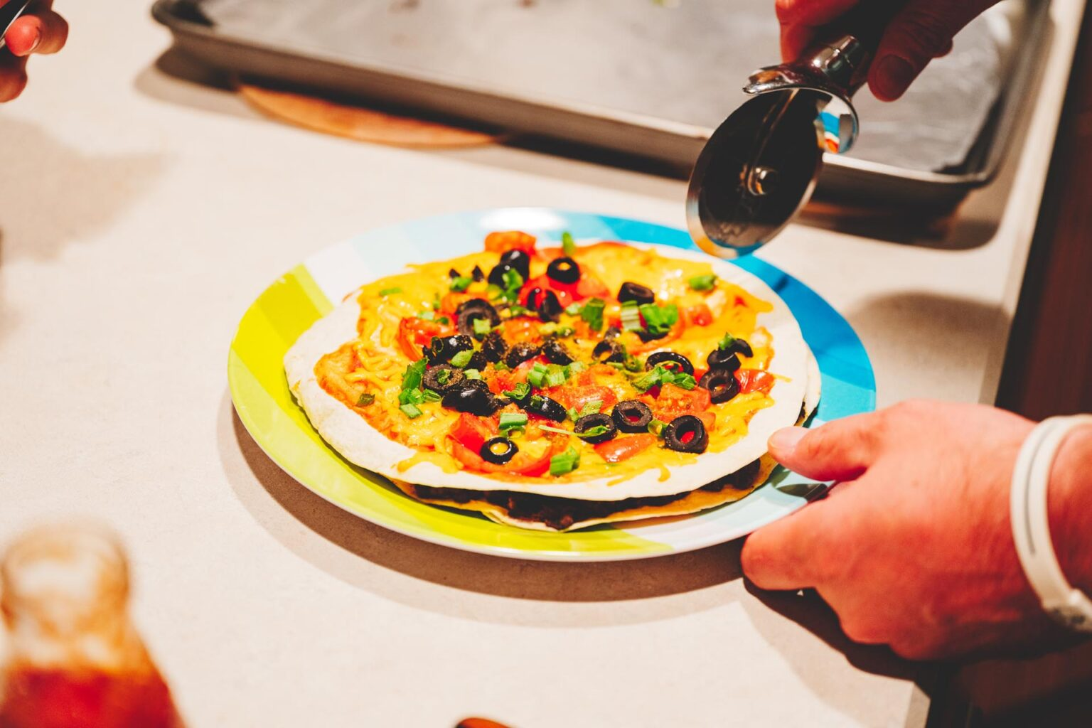 Cutting homemade mexican pizza