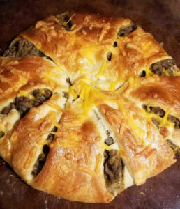 Image of cooked cheesy beef pastry ring