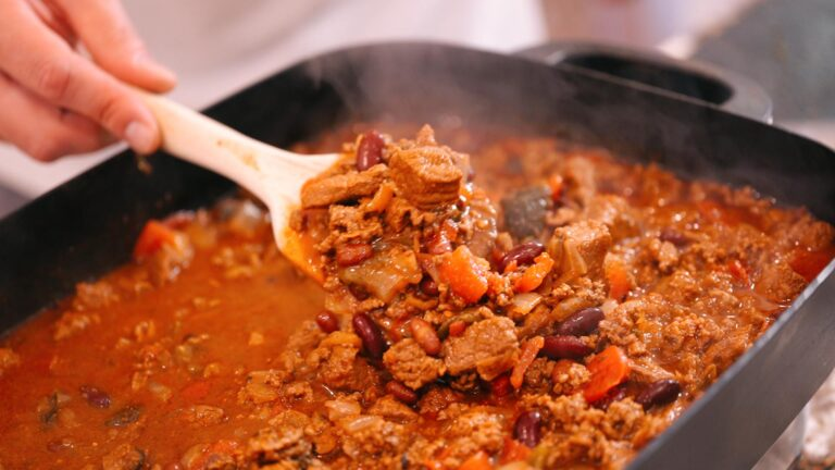 Image of chili in a pan with a serving spoon