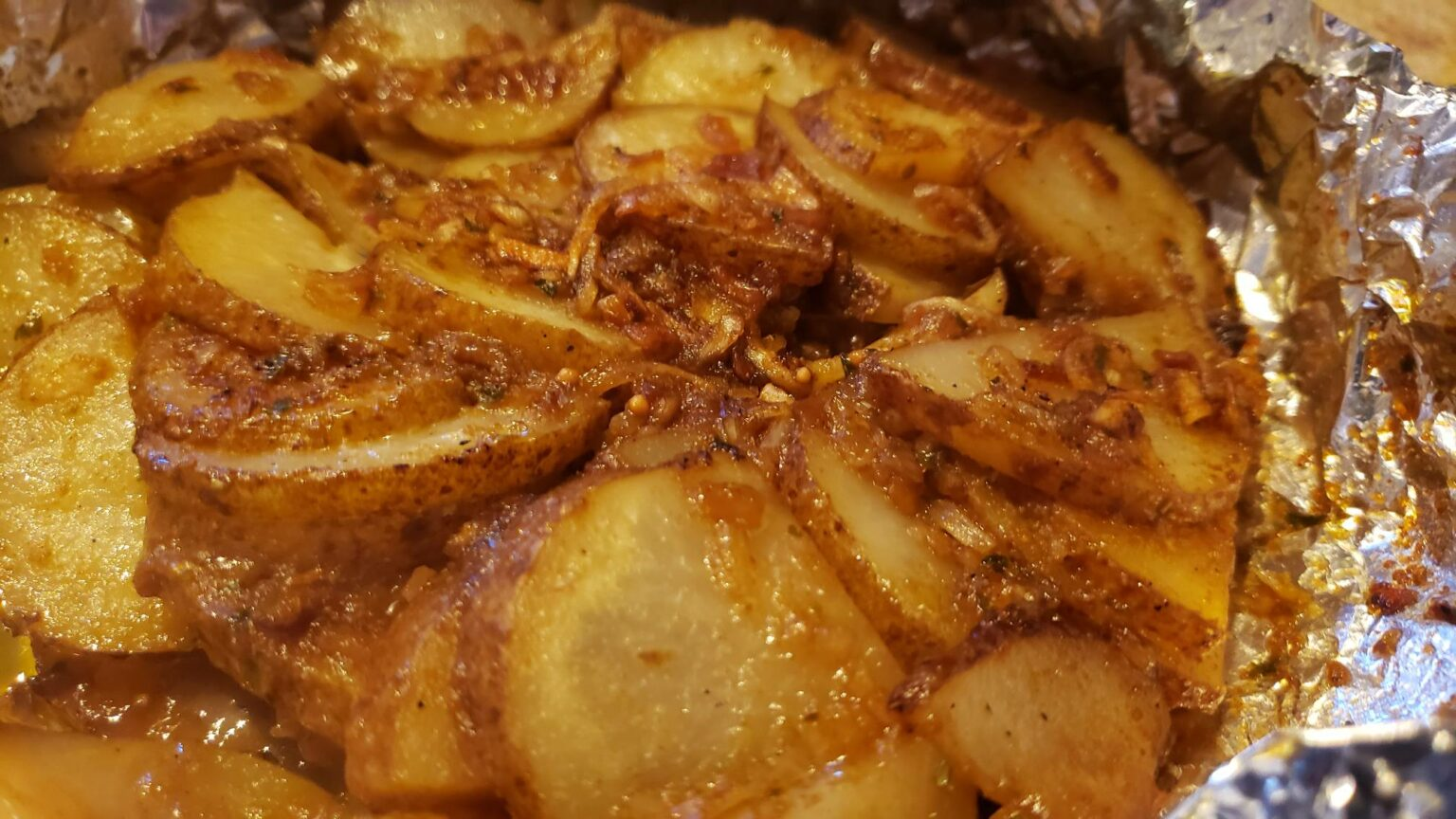 Picture of cooked onion soup mix potatoes in foil