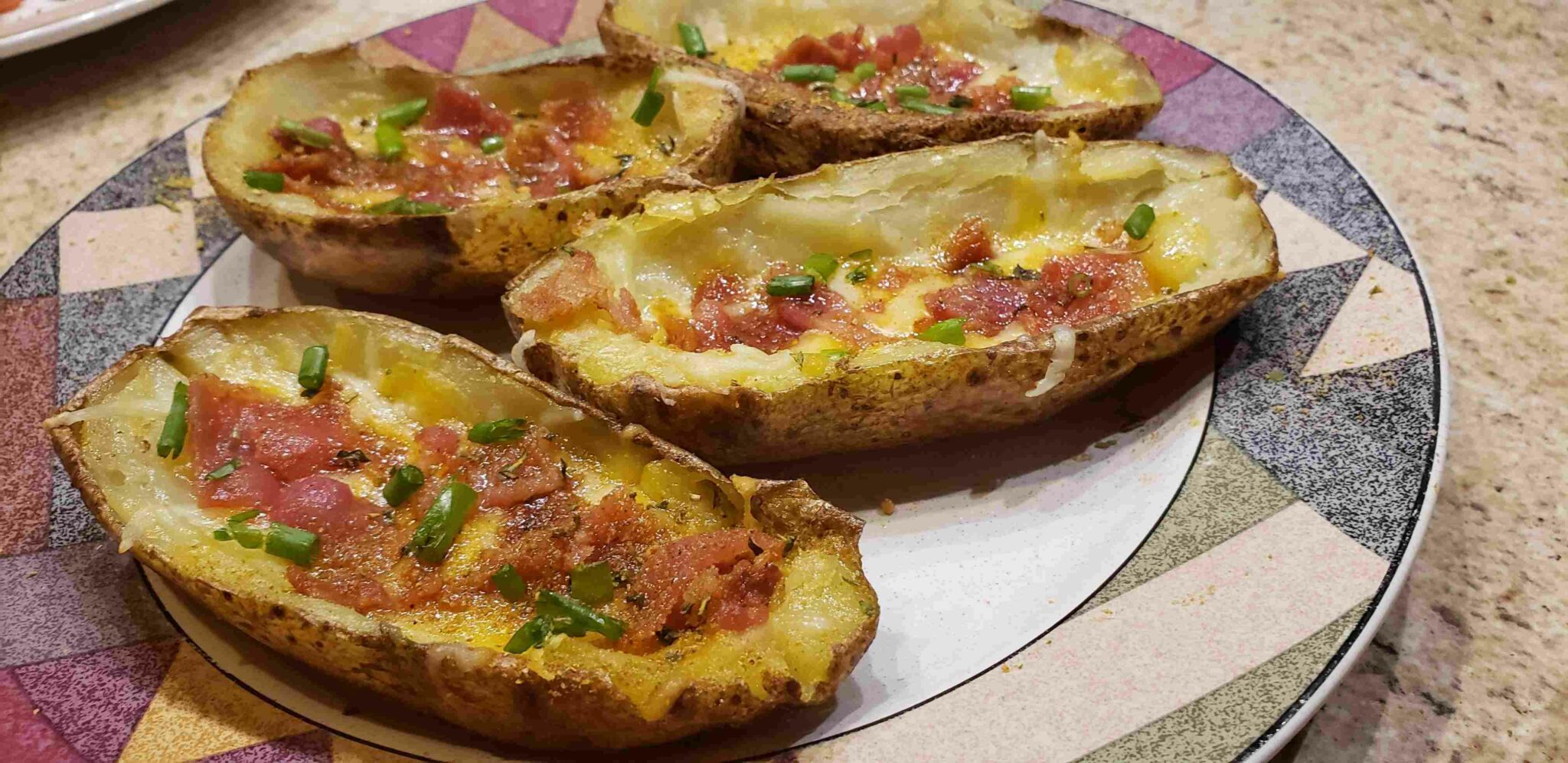 Image of loaded potato skins on plate