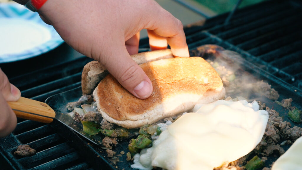 Making a philly sandwich on the grill