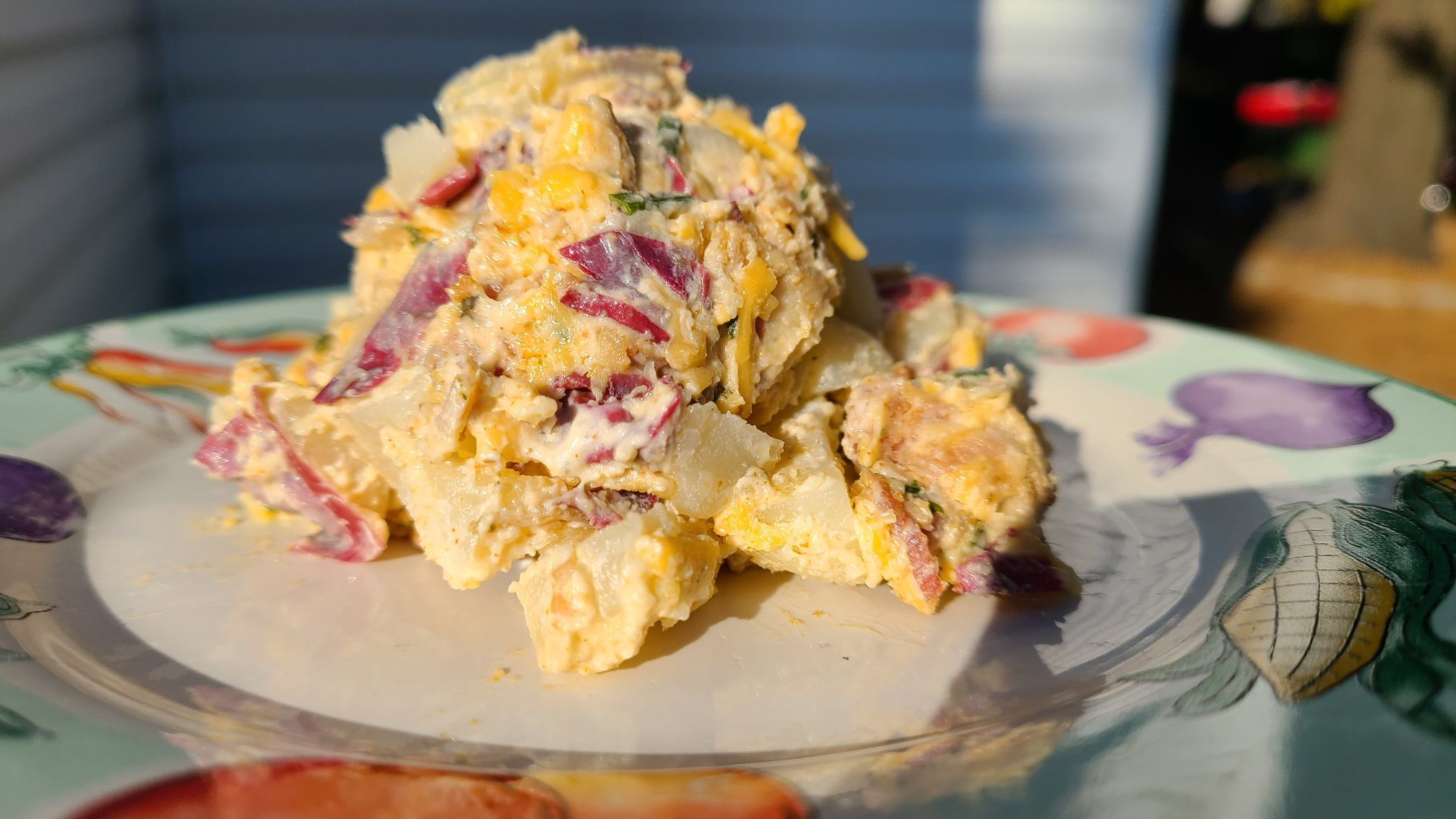 Image of loaded potato salad from recipe on plate