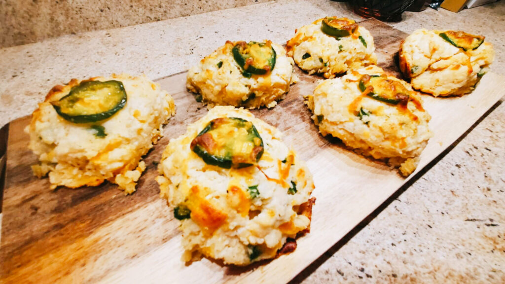 Image of jalapeno cheddar drop biscuits on a cutting board