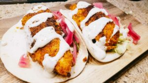 Nashville Hot Chicken tender tacos on cutting board