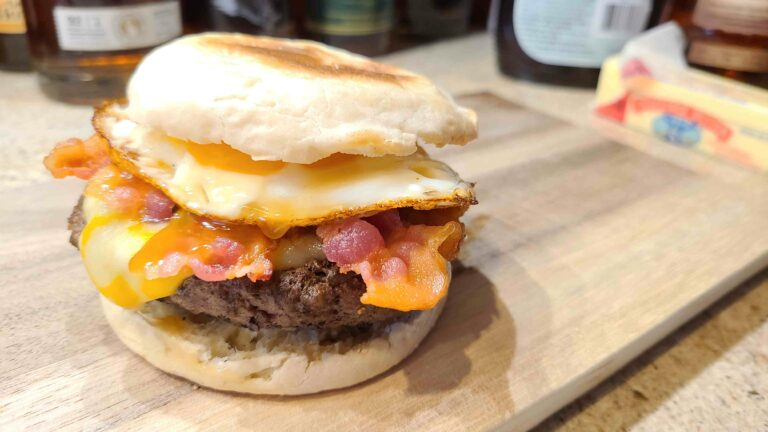 Breakfast burger on a cutting board ready to eat
