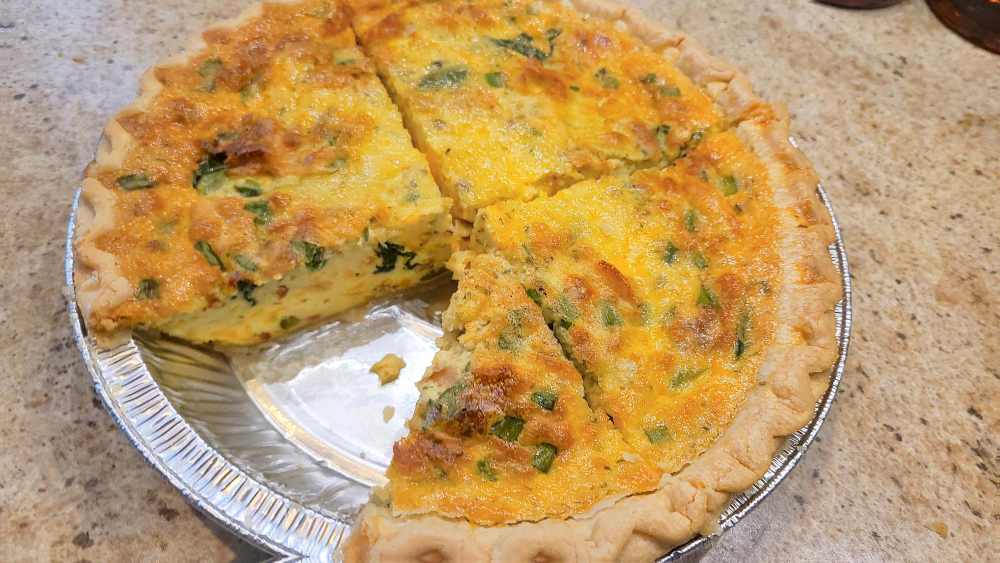 Picture of quiche with slice missing