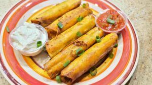 Chicken and cheese taquitos on a plate