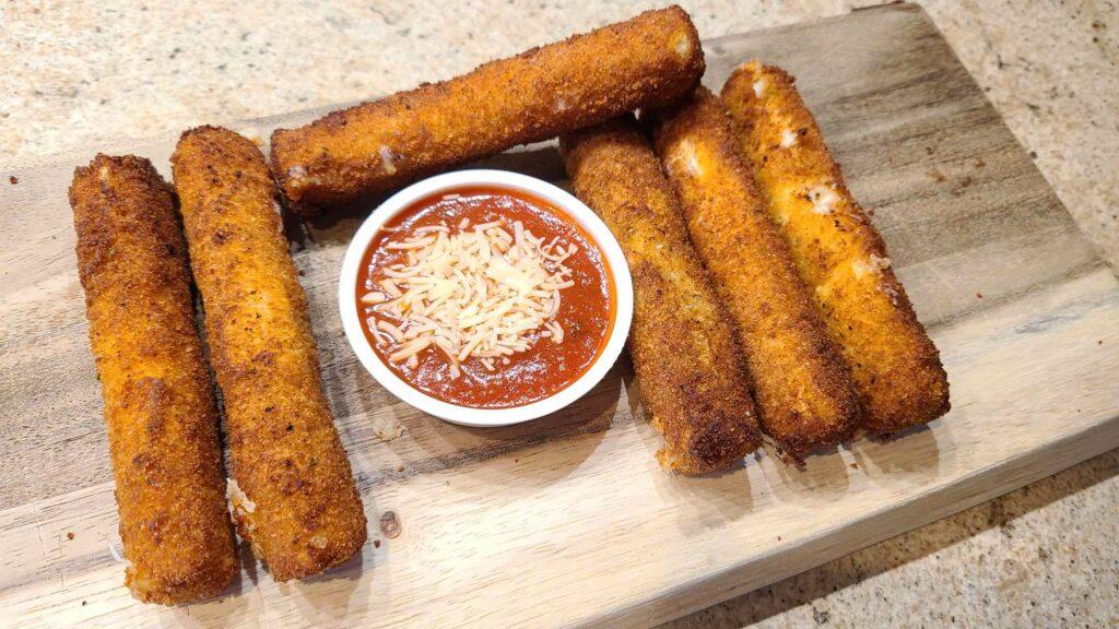 Homemade mozzarella sticks with marinara ready to eat