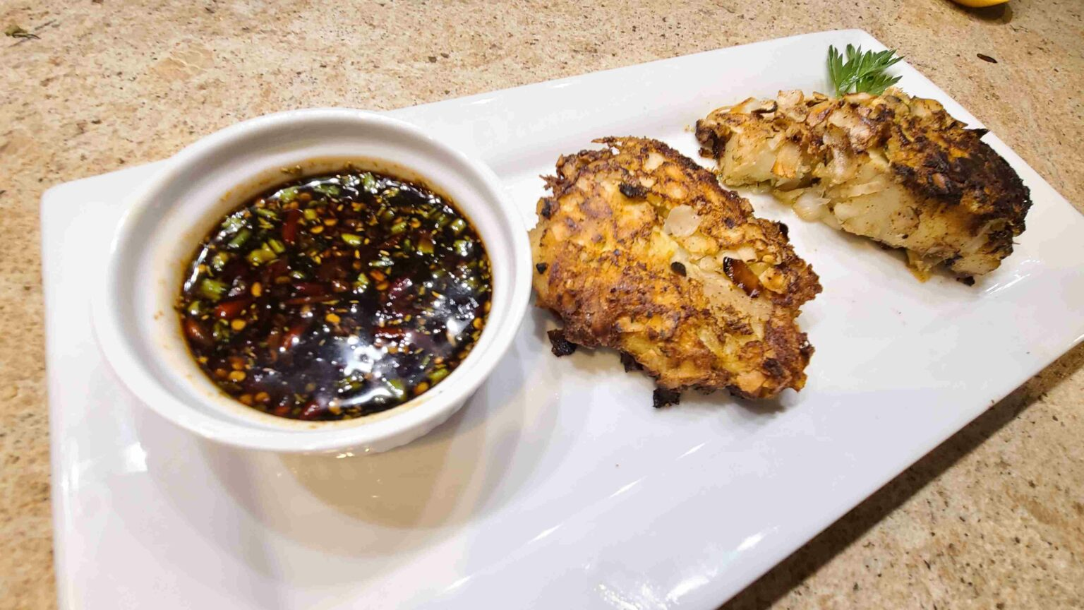 Coconut Crusted Cod with sauce ready to eat