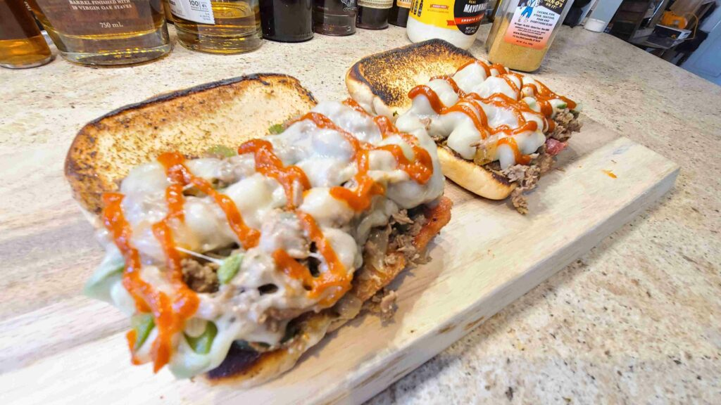 Spicy Philly Cheesesteak Sandwiches on cutting board