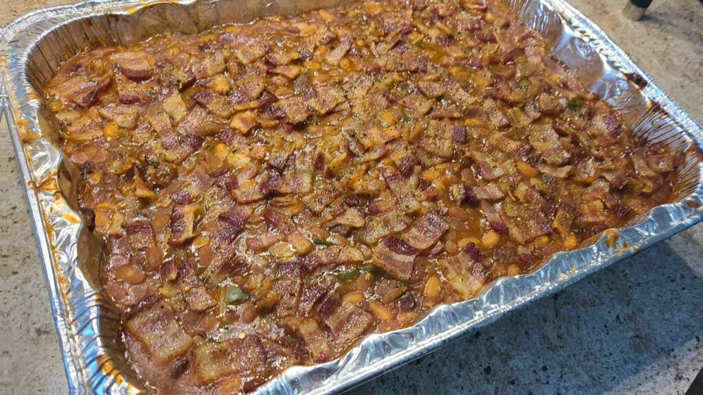 Cooked baked beans in aluminum pan