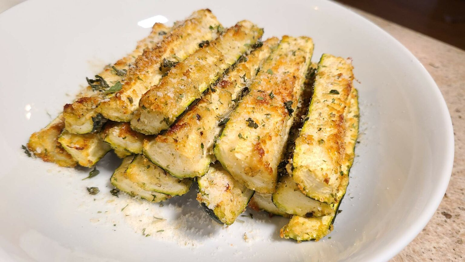 Baked Parmesan Zucchini fries on a plate