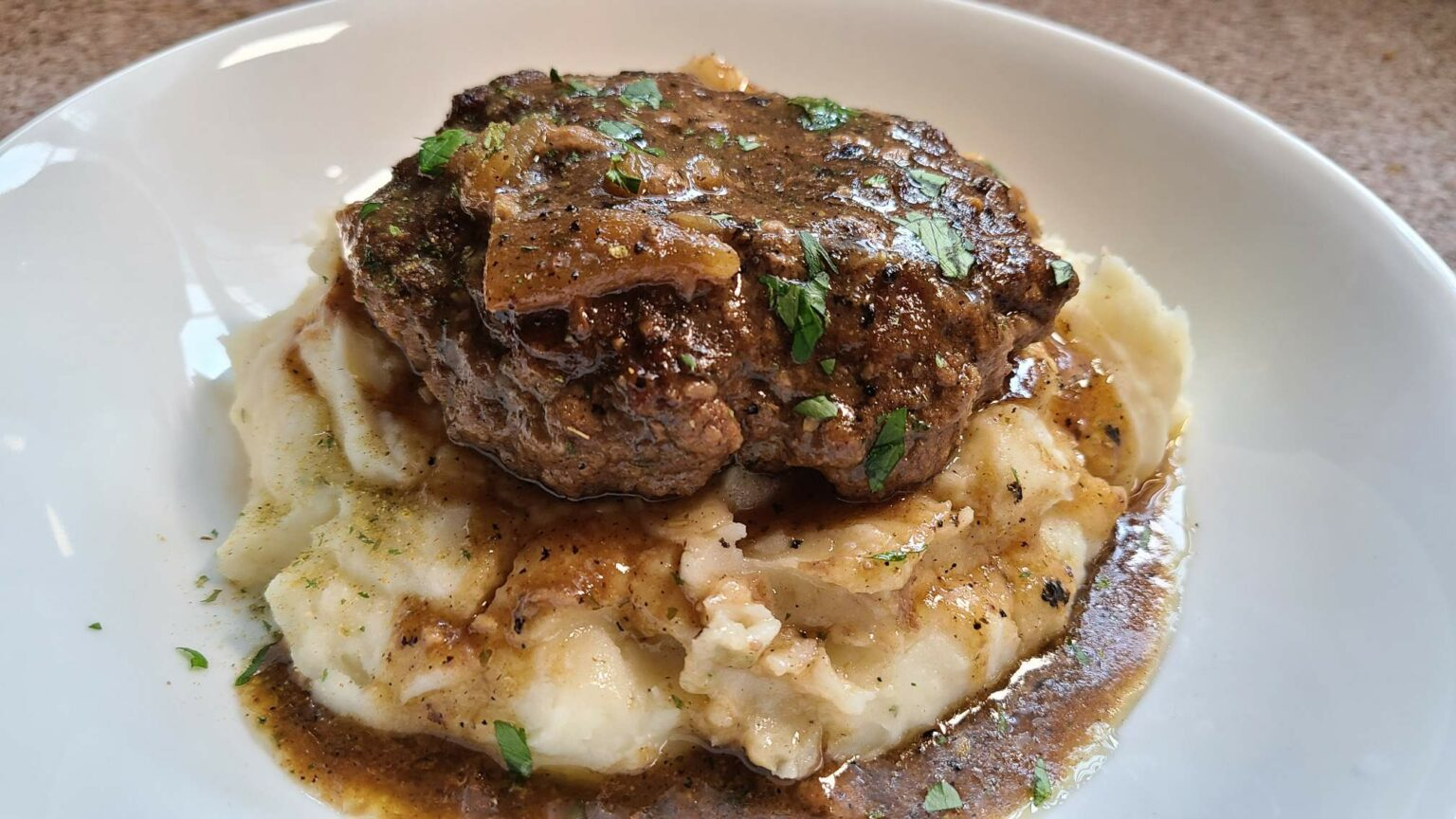 Salisbury Steak on mashed potatoes